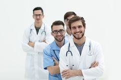 Gruppo di riusciti medici Isolato su bianco Fotografia Stock