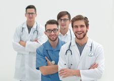 Gruppo di riusciti medici Isolato su bianco Immagini Stock Libere da Diritti