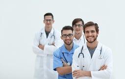 Gruppo di riusciti medici Isolato su bianco Fotografie Stock