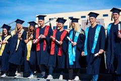 Gruppo di studenti dei giovani laureati Immagine Stock Libera da Diritti
