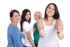 Gruppo di studenti felici isolati su fondo bianco - appena ragazza Fotografie Stock Libere da Diritti