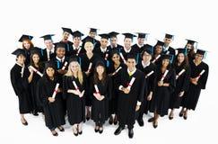 Gruppo di studenti graduati del mondo Fotografia Stock