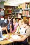 Gruppo di studio sulla tabella Immagine Stock