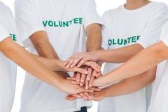 Gruppo di volontari che un le mani Fotografia Stock