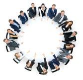 Gruppo felice di affari che indica a qualcosa fotografie stock libere da diritti