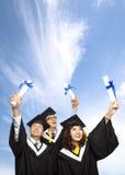 Gruppo felice di allievi di graduazione Fotografie Stock Libere da Diritti