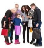 Gruppo felice di gente di acquisto che tiene le borse Immagine Stock