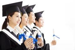 Gruppo felice di graduazione che guarda al futuro Fotografia Stock Libera da Diritti