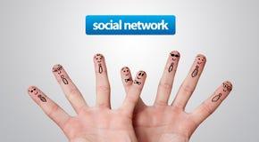 Gruppo felice di smiley del dito, rete sociale Immagini Stock