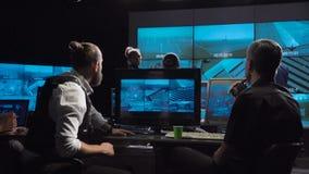 Gruppo futuristico di sorveglianza dell'ufficio delle forze speciali stock footage