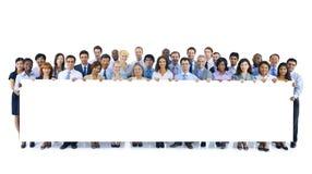 Gruppo grande di gente di affari che tiene bordo Immagini Stock Libere da Diritti