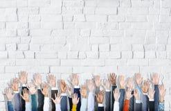 Gruppo multietnico di mani di affari sollevate Fotografia Stock