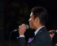 Gruppo permanente di vocals del pesce alla torre di Tokyo Immagini Stock Libere da Diritti