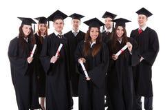 Gruppo sorridente felice di laureati multietnici Immagini Stock Libere da Diritti