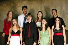 Gruppo vario di effettuazione di anni dell'adolescenza Fotografia Stock Libera da Diritti