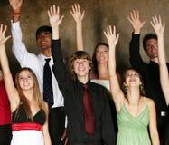 Gruppo vario di effettuazione di anni dell'adolescenza Fotografie Stock Libere da Diritti