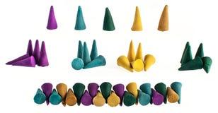Grups coloridos e cones individuais do incenso Foto de Stock