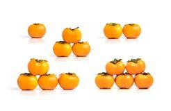 Grupy odizolowywać na białym tle dojrzały persimmon Obrazy Stock