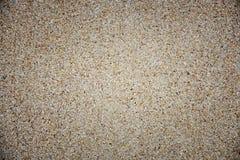 Grus, kiselstenar och sandcloseup Arkivfoton