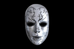 Gruselige Maske auf dem schwarzen Hintergrund Lizenzfreies Stockbild