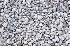 Grustextur Små stenar, Little Rockar, kiselstenar i många skuggor av grå färger, vit och blått Textur av Little Rockar Arkivfoto