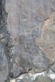 Gruta de Kuyuss Petroglyphs antigos Montanha Altai foto de stock