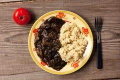 Grutten, gebraden paddestoelen en tomaat Stock Foto's