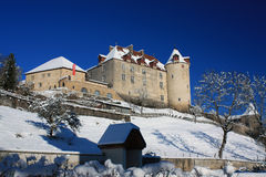 Gruyere Castle in winter, Switzerland. Build by the House of Gruyere somewhere in the mist of time before 11th century, the Chateau de Gruyere is today one of stock photo