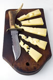 Gruyere cheese and knife Royalty Free Stock Image