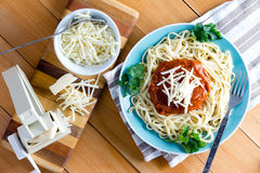 Gruyere cheese with pasta press and spaghetti Royalty Free Stock Images