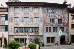 Gruyere, Switzerland - May, 2017: The street of old town touristic place, with painted with fresco ancient houses. stock images