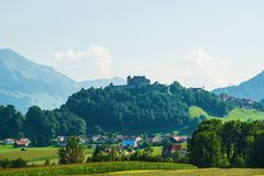 Gruyeres Castle and Prealps mountains in Canton Fribourg in Switzerland Stock Photos
