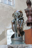 GRUYERES, SWITZERLAND - SEPTEMBER 08: H.R. giger museum, with several sculptures displayed around the entrance - September 08, 201 Stock Photo
