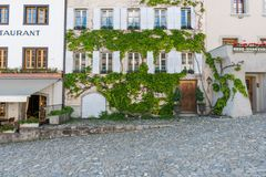 Gruyeres, VD / Switzerland - 31 May 2019: the historic medieval village of Gruyeres in western Switzerland with the village square royalty free stock photos