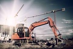 Grävskopa på konstruktionsplats Arkivfoto
