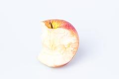 Gryźć jabłko nad bielem Obrazy Stock