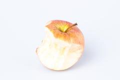 Gryźć jabłko nad bielem Fotografia Stock