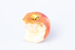 Gryźć jabłko nad bielem Obrazy Royalty Free