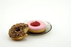 Gryźć pączki i naczynie donuts Zdjęcia Royalty Free