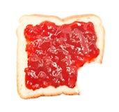 Gryźć z plasterka chleb z truskawkowym dżemem Obraz Royalty Free