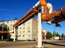Gryazi, Russia - June 21. 2018. pipes of above-ground heating main in heater. Gryazi, Russia - June 21. 2018. old pipes of an above-ground heating main in a royalty free stock images