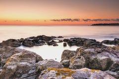gryning exponerad rockhavssun Royaltyfri Foto
