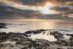 gryning exponerad rockhavssun Arkivbilder