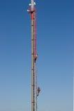 GSM antenna. Work in hight - GSM antenna repair Royalty Free Stock Photos