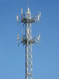 GSM Antenna. A GSM antenna with blue sky background Royalty Free Stock Photo