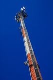 GSM antenna. Tall GSM antenna towards blue sky Stock Photography