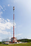 GSM antenna. GSM transmission antenna on cloudy sky Royalty Free Stock Photos