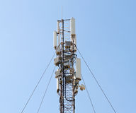 GSM Antenna against blue sky Royalty Free Stock Images
