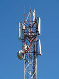 GSM antenna on blue sky Stock Photo