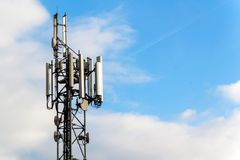 Gsm column on a blue sky background. Mediation of the telephone signal. Modern technology. Royalty Free Stock Image